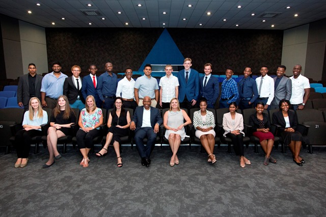 Altron bursary students with (front, centre) Melanie Kok, consultant at Bytes People Solutions, Mteto Nyati, Altron CE and Dr Madelise Grobler, director Studies for the Bill Venter Academy.